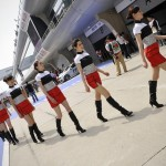 Chinese models walk the pit lane before